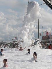 Children play in the foam from the Gallatin Fire Department's