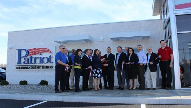 Board members, community business leaders and others participated in the ribbon-cutting for Patriot Federal Credit Union's new Lincoln Way East branch on April 19.