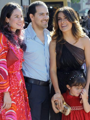 Salma Hayek, right, her daughter Valentina Pinault, and her brother Sami Hayek, center, with Daniela Villegas, left, arrive at a premiere at in Westwood, Calif. in October 2011. Sami Hayek was hospitalized with broken ribs after being involved in a Los Angeles car crash that killed his passenger on Feb. 23, 2014.