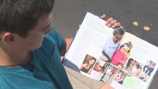 Mesa High School senior Gregory Gomez shows a section of his yearbook highlighting student-parents.