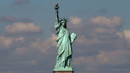 The Statue of Liberty, one of New York's premiere tourist attractions, is viewed from the Staten Island Ferry on Sept. 30, 2013.