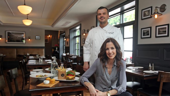 Chef Eric Woods and his wife and co-owner, Paula Woods, are photographed at their restaurant 14 and Hudson kitchen and bar in Piermont on June 10, 2014.