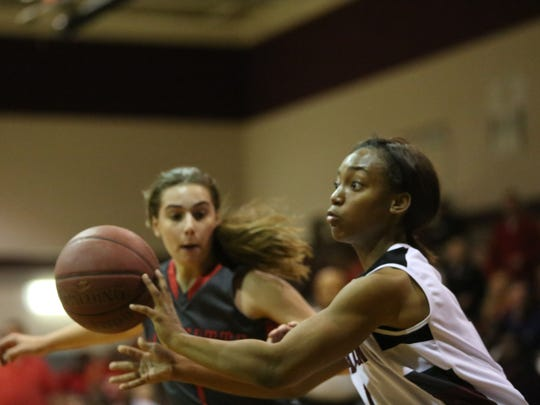 Madison County's Tamiera Mobley makes a no-look pass against Lafayette during a 36-25 win in the Region 2-1A final.