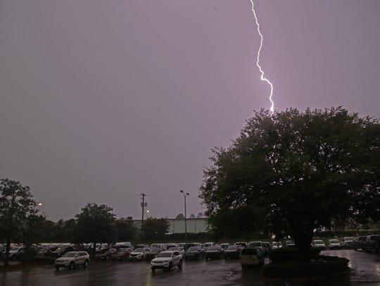 Lightning splits the sky over the Tallahassee Democrat