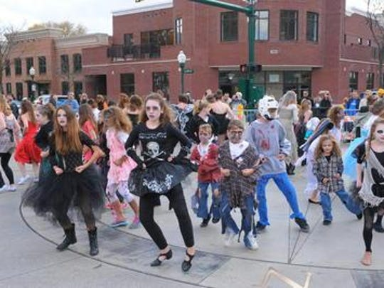 "A flash mob from Synergy Dance Academy performed to Michael Jackson's ""Thriller"" at the 2013 Pumpkin Palooza in downtown Plymouth."
