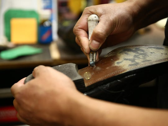 Refugio Contreras uses a cutter to create a channel