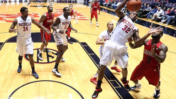 Ole Miss guard Jarvis Summers tries to grab a rebound against Western Kentucky.