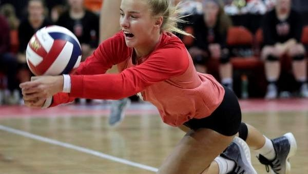 Lourdes Academy's Morgan Thiel dives for a ball against Benton in a Division 4 state semifinal volleyball match Friday at the Resch Center in Ashwaubenon.