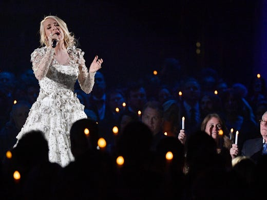"Carrie Underwood sings ""Softly and Tenderly"" in a tribute"