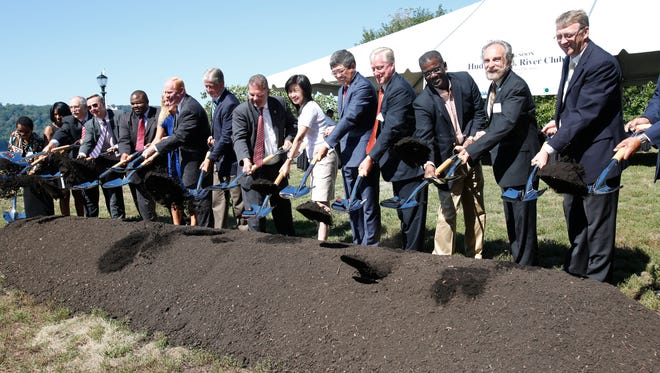 Yonkers Mayor Michael Spano, along with representatives from China, Strategic Capital and Collins Enterprises, break ground on the final phase of the Hudson Park River Club construction in Yonkers on Sept. 15, 2015.