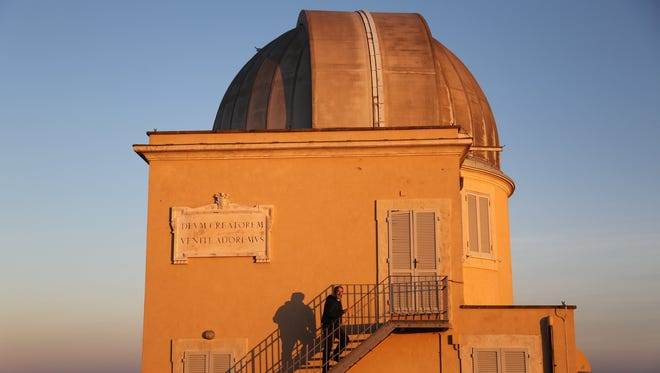 In December 2013, Brother Guy Consolmagno, a native of metro Detroit and one of 12 Vatican astronomers, climbs the steps of one of the two observatories at the Vatican Observatory. Kathy Kieliszewski/Detroit Free Press