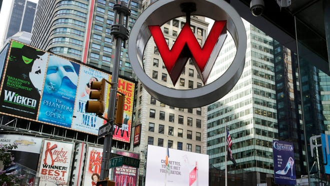 The logo for the W Hotel, owned by Starwood Hotels & Resorts Worldwide, is seen in New York's Times Square in 2013. Marriott International announced Monday, Nov. 16, 2015, it is buying rival hotel chain Starwood for $12.2 billion in a deal that will secure its position as the world's largest hotelier.