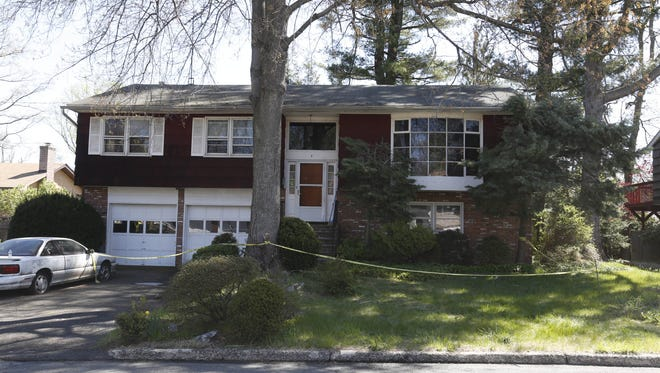 The scene of a fatal house fire at 7 Frost Lane in Hartsdale on May 5, 2014. John Chu, 89, died in the fire; Nan Chu, 85, died three weeks later, at Westchester Medical Center.