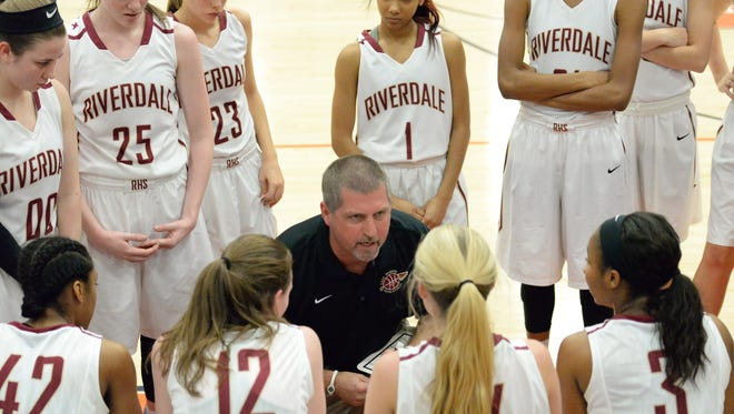 Riverdale girls coach Randy Coffman addresses his team during Friday's win over Northview (Ga.) Riverdale beat West Forsyth (Ga.) on Saturday.