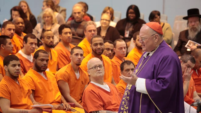 His eminence Timothy Cardinal Dolan lead a mass for detainees at the Westchester County Jail in Valhalla on Dec. 21, 2015.