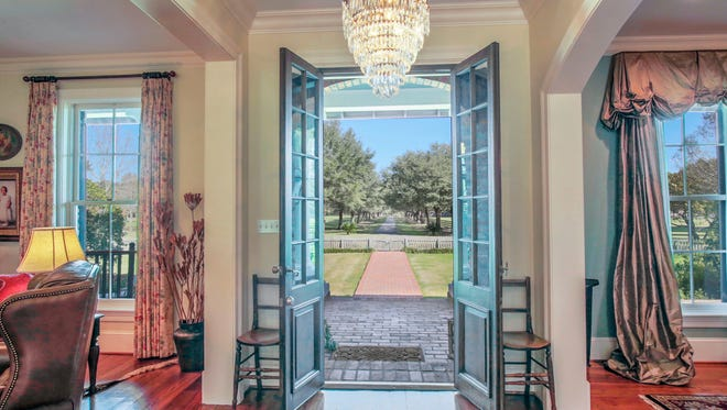 The stunning entrance to the home offers gorgeous views of the property