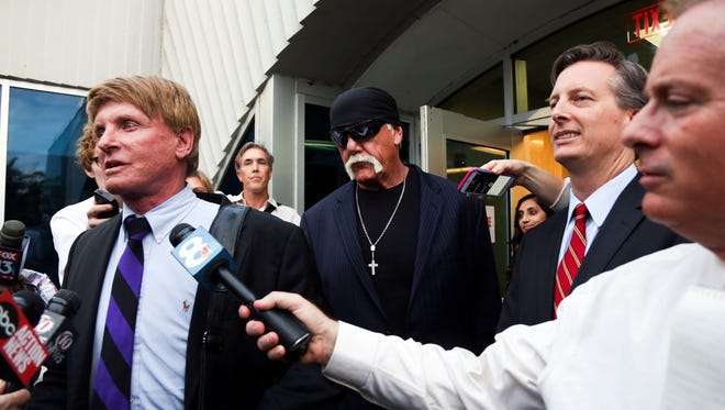 Hogan attorney David Houston speaks to the media outside of the courthouse on Friday, March 18, 2016, in St. Petersburg, Fla. Hulk Hogan, whose given name is Terry Bollea was awarded $115 million in damages in his lawsuit against the gossip website Gawker on Friday.  (Eve Edelheit/The Tampa Bay Times via AP)