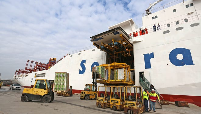 Fruit from Chile is offloaded from a ship at the Port of Wilmington.