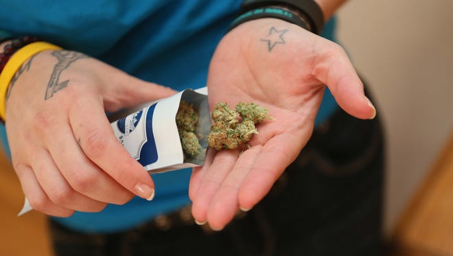 A Delaware patient shows their authorized medical marijuana.