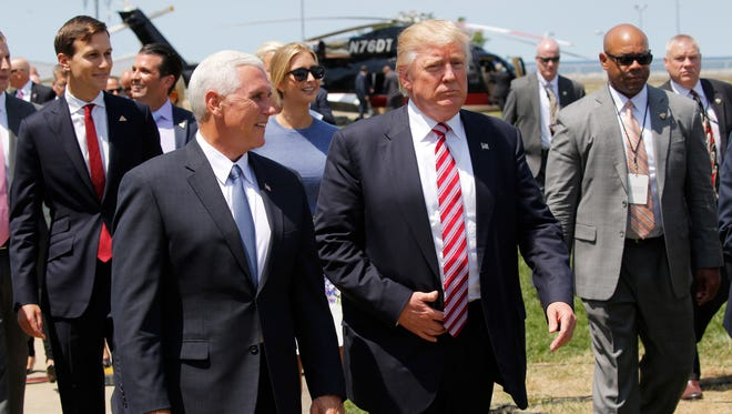Republican presidential nominee Donald Trump and his family attend a welcome arrival event with Governor Mike Pence and his family at the Great Lakes Science Centre on July 20, 2016 in Cleveland, Ohio.