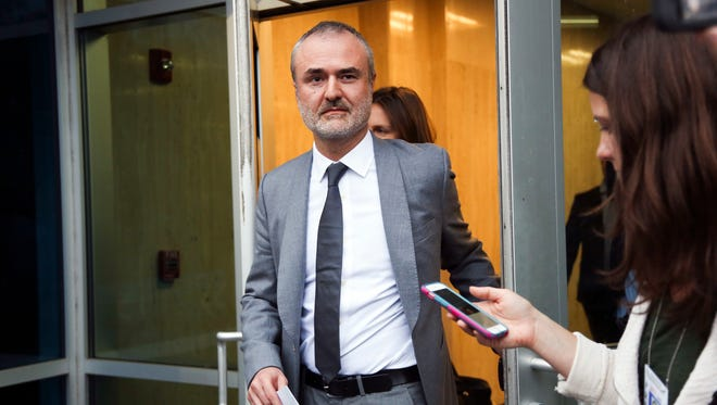 FILE - In this Friday, March 18, 2016, file photo, Gawker founder Nick Denton walks out of the courthouse in St. Petersburg, Fla. Gawker.com is going to shut down as its parent company is sold to Univision, a reporter for the 14-year-old site said Thursday, Aug. 18, 2016. A Gawker report said that Denton told staffers that Gawker.com was ending on Thursday afternoon.