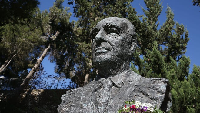 A bronze chest statue of late Israeli ex-president and Nobel Peace Prize winner Shimon Peres is taken at the gardens of the President's Residence in Jerusalem.