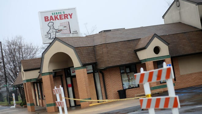 A barricade blocks the street outside Serpe & Sons in Elsmere following a Dec. 24 fire. The business is suing the oven manufacturer.
