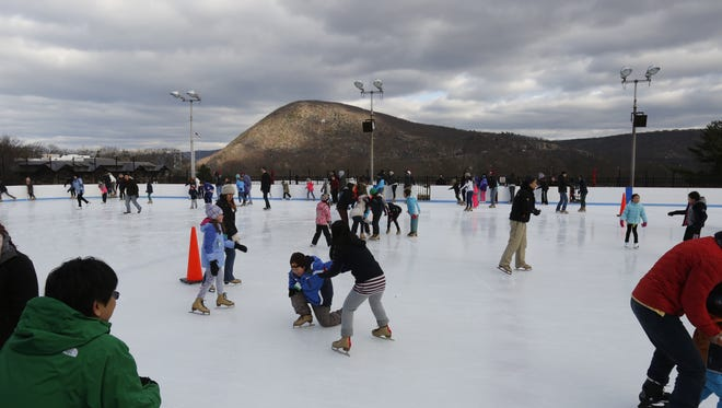 Skaters enjoy the outdoor ice rink at Bear Mountain State Park.