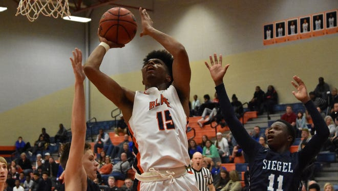 Blackman's Bryce Williams shoots while Siegel's Ethan Jones watches.