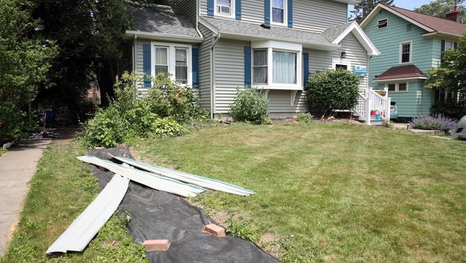 An Irondequoit home was damaged on June 18, 2017, by a fire between two houses. Fire fighters believe the fire was caused by leftover fireworks that were put near the garbage outside.