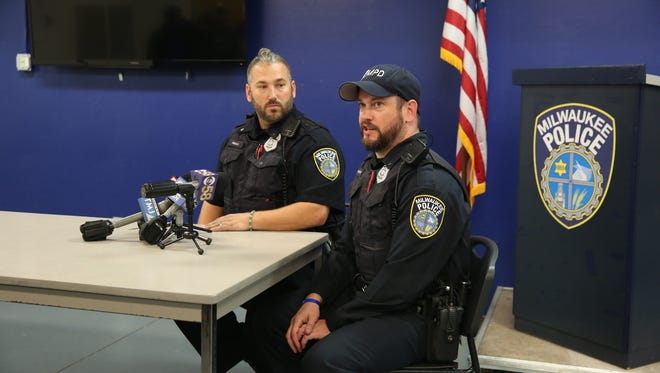 Milwaukee police officers Vin Paolo (left) andDan Resnick talk about helping a mother and her 2-year-old son who were living in a vacant house.