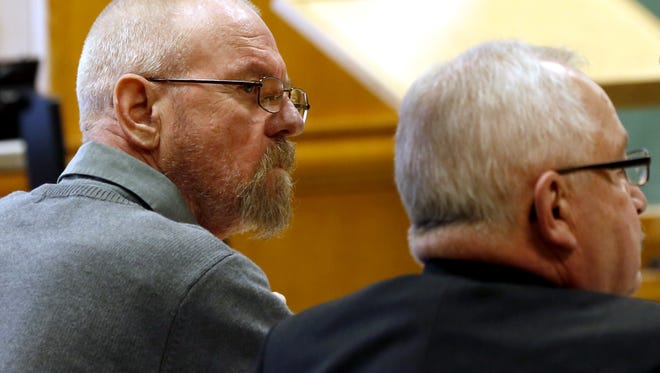 Mark Kusters, left, listens to witness testimony with his defense attorney Gary Kryshak during Kusters' trial for first-degree intentional homicide, at the Wood County Circuit Court in Wisconsin Rapids, Wis., on Monday, November 6, 2017.