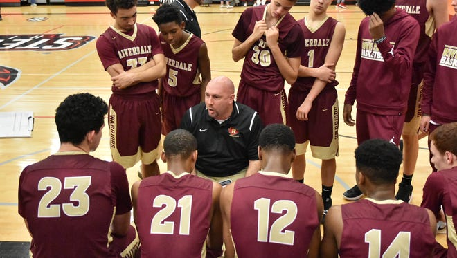 Riverdale coach Michael Voss talks to his players during a recent game. Voss and the Warriors are off to a 14-1 start.