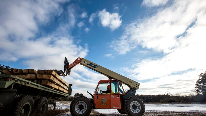 A student operates a machine practicing efficiently loading and unloading wood at the Wisconsin Operating Engineers Training Center in Coloma, Wis., December 12, 2017.