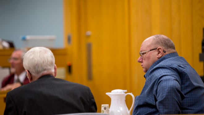 Scott Sawyer listens to testimony during his reckless homicide trial at the Portage County courthouse in Stevens Point, Wis., Wednesday, January 10, 2018.