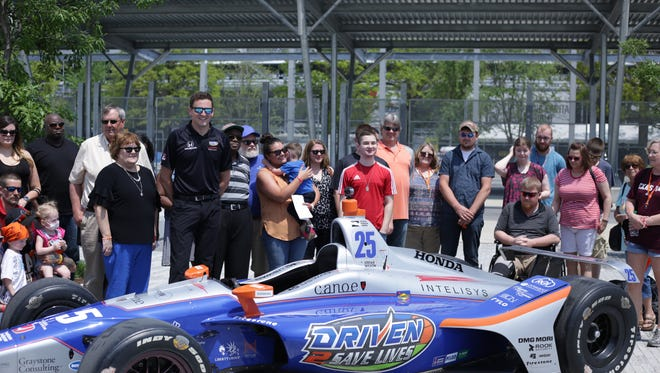 Indy 500 driver Stefan Wilson with patients and families on May 14.