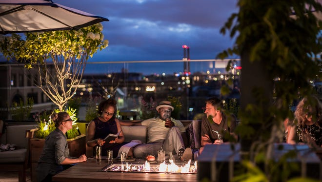 Nights are cozy on the rooftop bar of the Journeyman Hotel.
