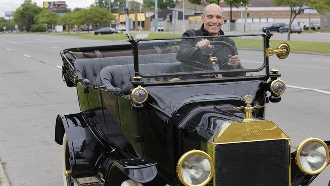 Geoffrey Baer travels in a Model T down Detroit's Woodward Avenue for 'Ten Roads That Changed America' on PBS.