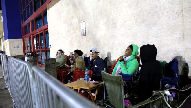People wait in line at Best Buy on Thanksgiving in 2012.