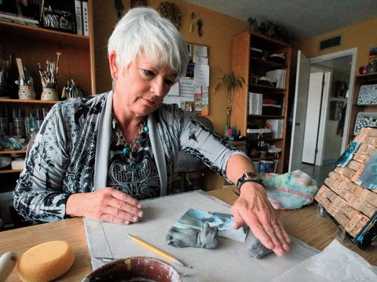 El Paso artist Deana Hicks works on a pottery pet art piece in her home studio at 6421 Clouidview in West El Paso. Hicks, who does painting, pottery and jewelry will open her studio to the public during the 2015 Artists Studio Tour.