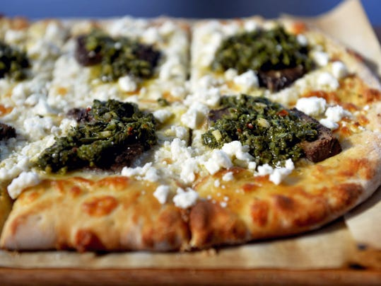 BrewVino's in York has an array of specialty pizzas and craft beers on tap. This is Chimichurri steak pizza.