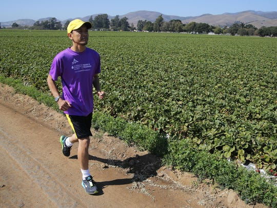 Binzee Gonzalvo, a Salinas native, flew in from Tokyo, Japan warms up Wednesday for Saturday's Salinas Valley Half Marathon. He is a cancer survivor.
