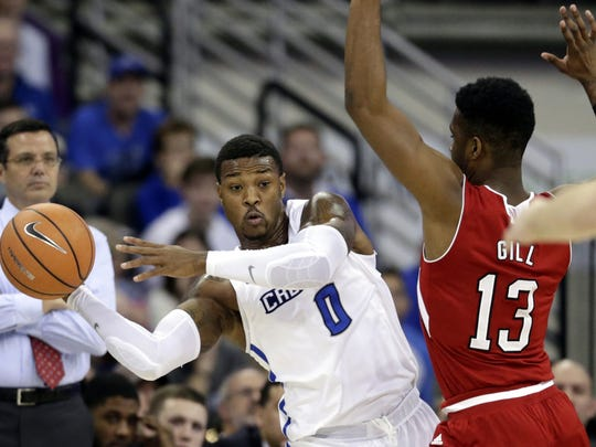 Creighton's Marcus Foster (0) passes the ball around Nebraska's Anton Gill (13) during the first half of an NCAA college basketball game in Omaha, Neb., Saturday, Dec. 9, 2017. Foster, a senior from Hirschi High School, is among the Big East leaders in scoring and 3-point shooting and converting career-high percentages from the field and 3-point arc.