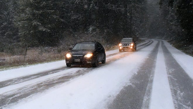 Motorists drive near Yelm, Wash., on Dec. 24, 2017. Snow, sleet and freezing rain is making holiday travel challenging in Washington state, Oregon and Idaho. AccuWeather warned that more winter weather will make travel hazardous in the Pacific Northwest, the Great Lakes region and New England early this week.