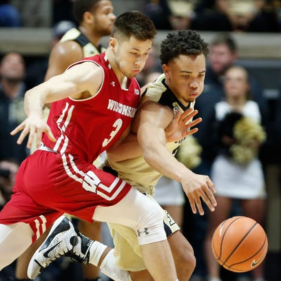 Carsen Edwards of Purdue reaches in to steal the ball
