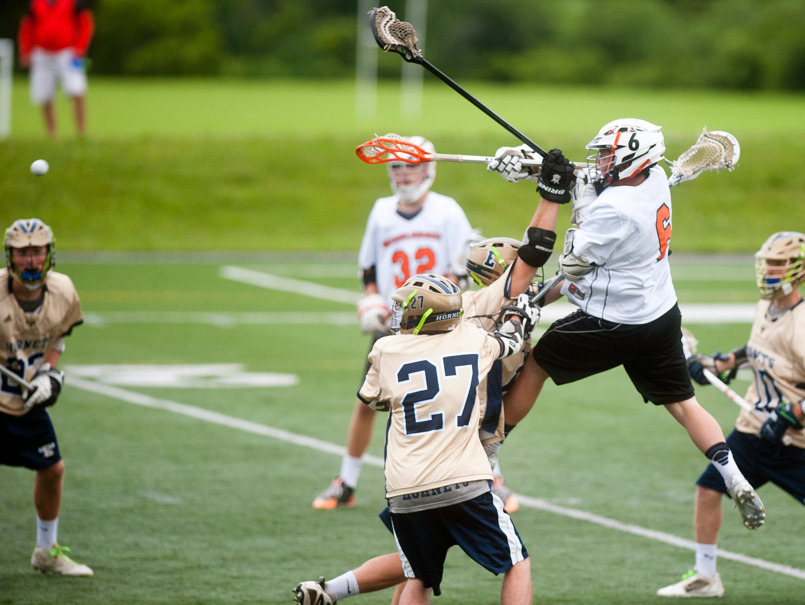 Middlebury's Jack Hounchell (6) leaps to unleash a shot back at the Essex goal during the teams' Division I boys lacrosse semifinal on Tuesday at Middlebury College.