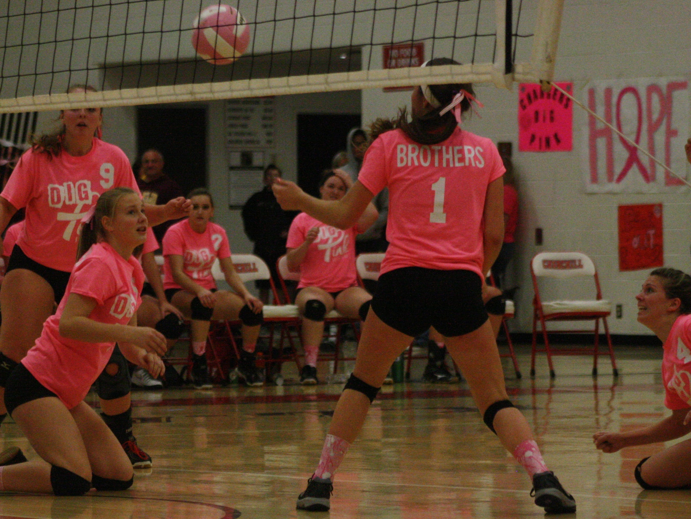 Members of Franklin's volleyball team hit the floor to keep this point alive Tuesday night.