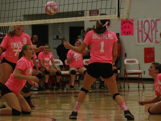 Members of Franklin's volleyball team hit the floor