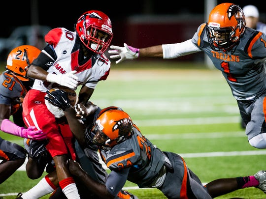 Immokalee High School's Jean Sanon tries to hold on to the ball during a game against Lely High School in Naples, on Friday, Oct 28, 2016.