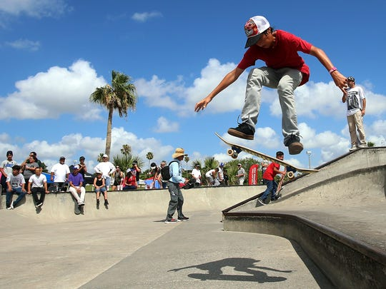 Zachary Lopez perform a trick during Go Skateboarding Day on Saturday, June 18, 2016, at Cole Park in Corpus Christi.